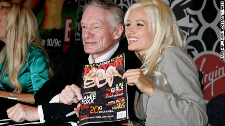 Hefner and Madison sign copies of the November 2005 issue of Playboy in New York City.