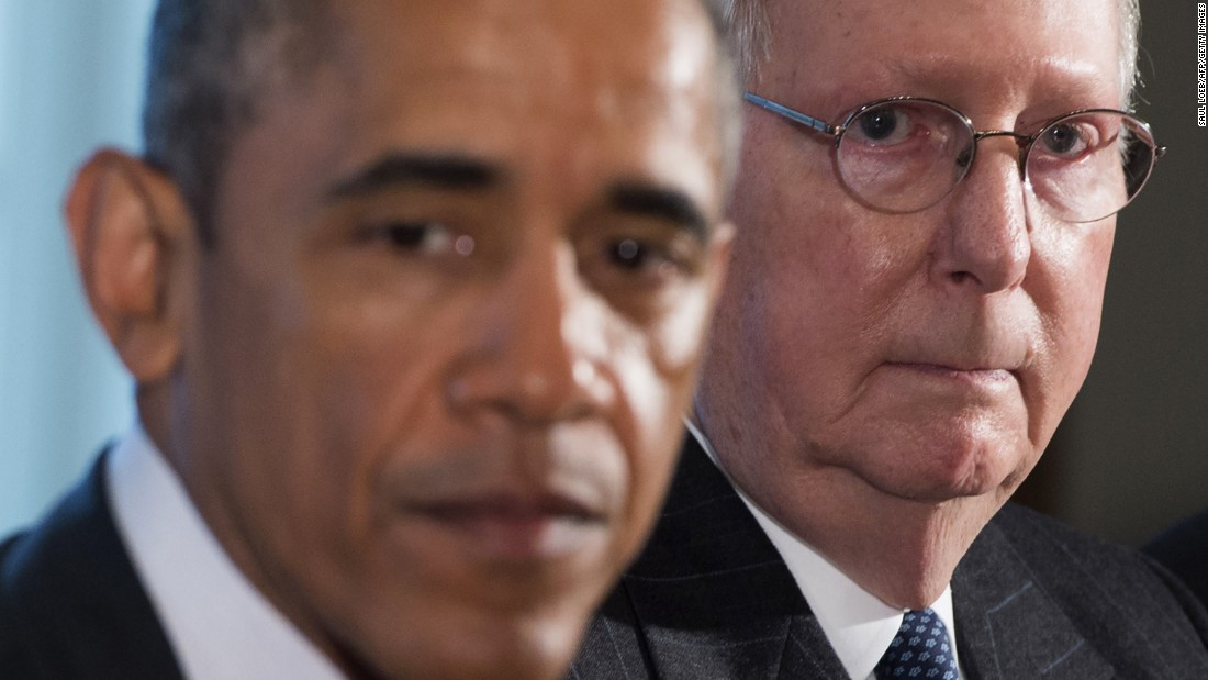 President Barack Obama sits beside McConnell before a meeting in the Cabinet Room at the White House on January 13.