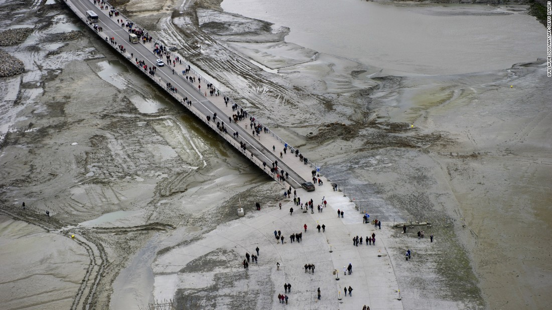 Around 3 million people visit each year. Here, some are seen walking to the site before the water rose.