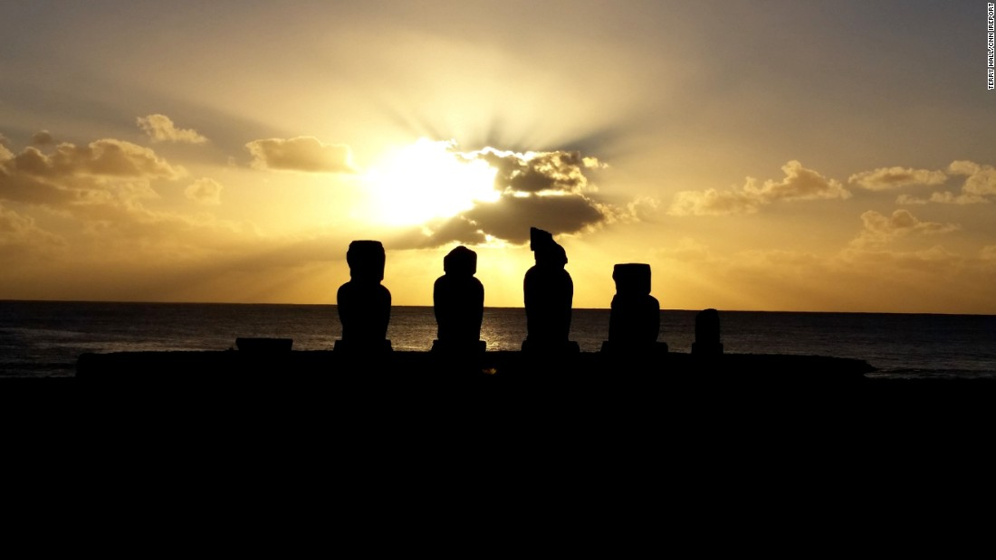 "Easter Island, also called Rapa Nui, is known for its  giant stone statues. Hundreds of statues stand tall, revealing three distinct cultural periods. The island is in the Pacific more than 2,000 miles west of Chile. ""One of the most isolated islands in the world? That may be, but don't let that dissuade you,"" wrote <a href=""http://ireport.cnn.com/docs/DOC-1221273"">iReporter Terry Hall</a>."