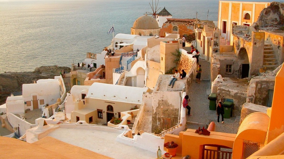 """Incredible scenery, quaint villages, fabulous beaches, wineries, great food and some of the finest sunsets you will see."" That's what Santorini has going for it, according to <a href=""http://ireport.cnn.com/docs/DOC-1221238"">iReporter Robert Pozner</a>. This shot was taken around sunset in the village of Oia."