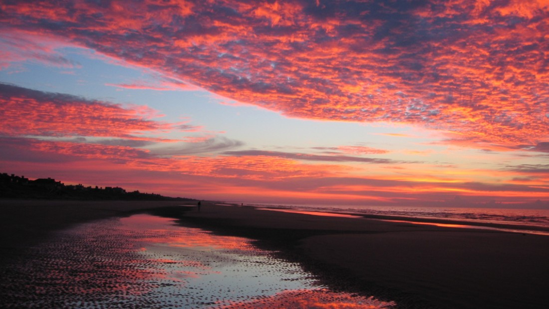 "<a href=""http://ireport.cnn.com/docs/DOC-1220413"">Betsey Porter</a>, who lives in Bloomington, Minnesota, was visiting her parents at their vacation home on Kiawah Island when she captured this fiery sunrise. ""I could not believe such a place existed when I went the first time 10 years ago.  If you are a golfer or a foodie or a beach or nature lover, you can't find a better spot than this,"" she wrote."