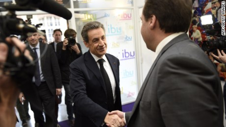 President of the center-right party UDI Jean-Christophe Lagarde (R) shakes hands with UMP right-wing party president Nicolas Sarkozy (C) before a meeting at the UDI headquarters in Paris on March 23, 2015. The French right was celebrating today after local elections saw a conservative alliance and the far-right National Front triumph over the ruling Socialists in a key test ahead of the 2017 presidential poll. An alliance led by Sarkozy took first place in Sunday's first-round polling with 29.4 percent of the vote, while the National Front (FN) of Marine Le Pen came second with 25.2 percent, according to latest figures from the interior ministry. AFP PHOTO / MARTIN BUREAUMARTIN BUREAU/AFP/Getty Images