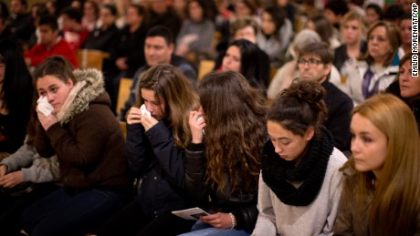 Friends of the German students from the crashed plane attend a mass in Llinars del Valles, near Barcelona, Spain, Tuesday, March 24, 2015. Sixteen 10th-grade students from a town in western Germany and two of their teachers had just spent a week on an exchange near Barcelona and were less than an hour from landing when their Germanwings flight crashed in southern France. Officials confirmed Tuesday they were among the 150 people who died in the crash. (AP Photo/Emilio Morenatti)