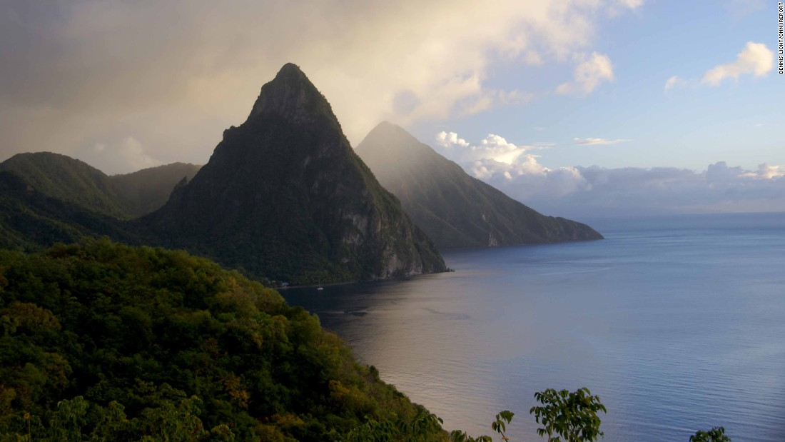 "Saint Lucia stretches 27 miles long in the Caribbean Sea.<a href=""http://ireport.cnn.com/docs/DOC-1220562""> iReporter Dennis Licht </a>enjoyed ""the gorgeous scenery, the lush vegetation and watching the storms roll over the Pitons, as this picture illustrates."""