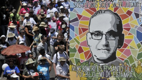 Catholic faithfuls march holding a banner depicting the late Monsignor Oscar Arnulfo Romero, in San Salvador on March 24, 2015, during the 35th anniversary of his murder. Romero will be beatified in El Salvador next May 23, 2015. AFP PHOTO / MARVIN RECINOSMarvin RECINOS/AFP/Getty Images