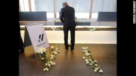 A Lufthansa employee signs in a condolence book in Frankfurt, Germany, on March 25.