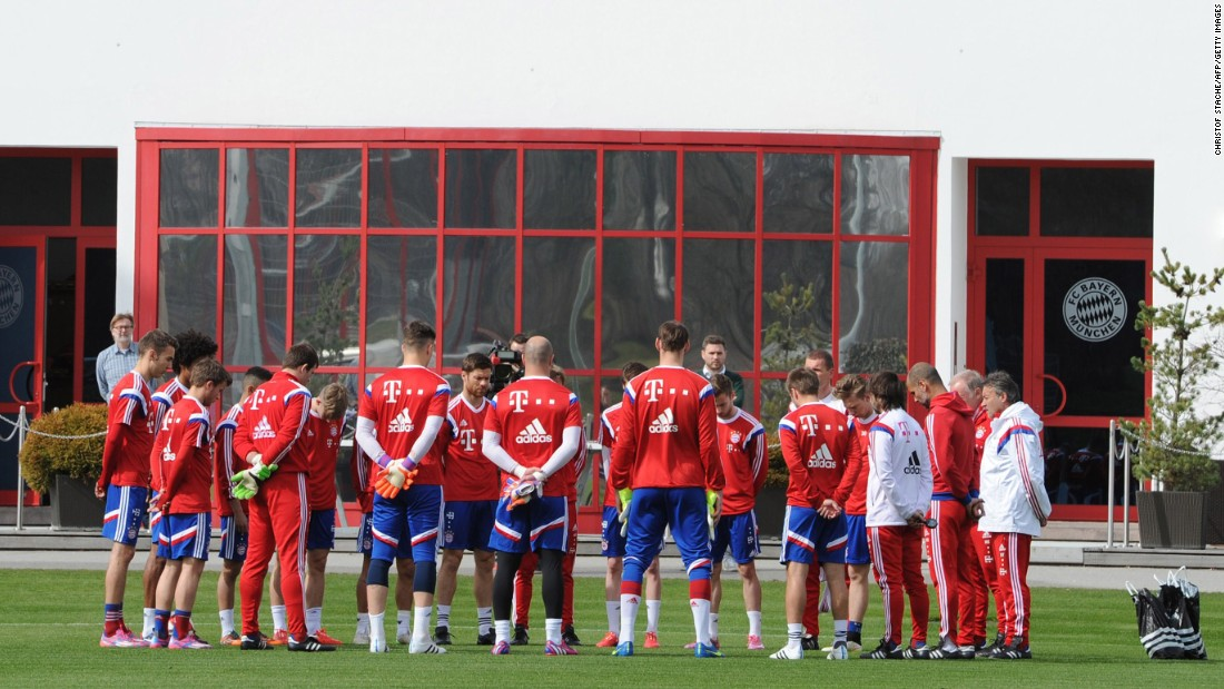 Members of the German soccer club Bayern Munich hold a moment of silence before their practice in Munich on March 25.