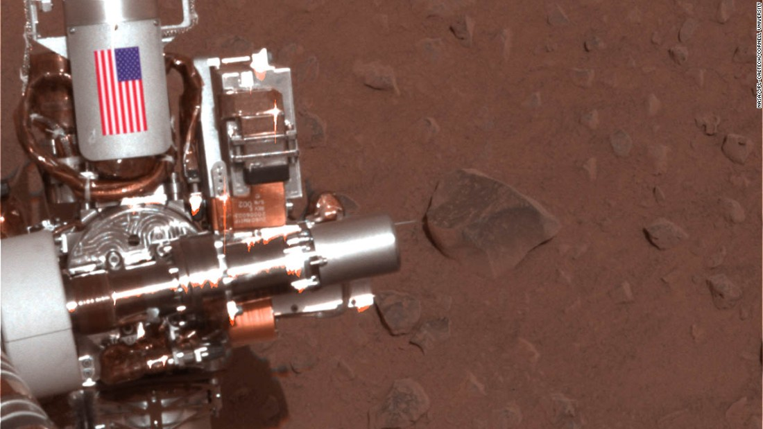 The Mars Spirit rover. Both rovers feature a piece of metal with the American flag on the side. They are made of aluminum recovered from the site of the World Trade Center towers in New York City.