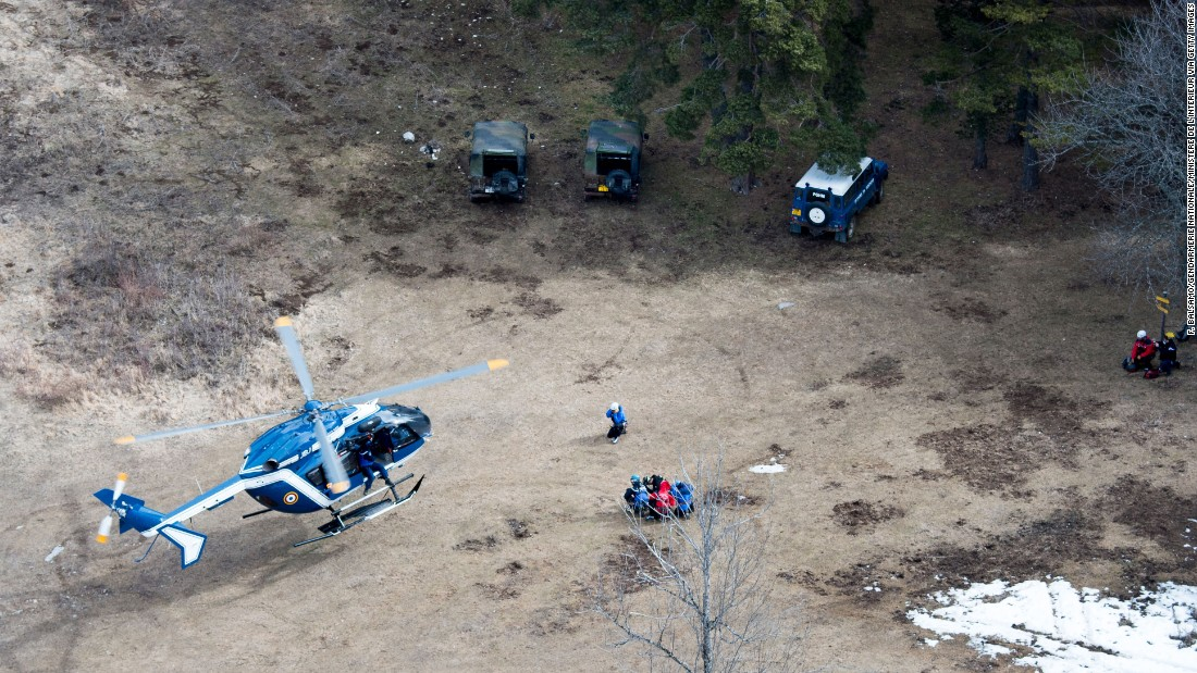 Search-and-rescue teams land near the crash site on Wednesday, March 25.