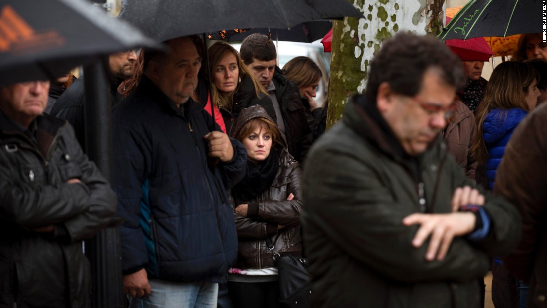 People pause for a moment of silence in Llinars del Valles, Spain, on Wednesday, March 25.