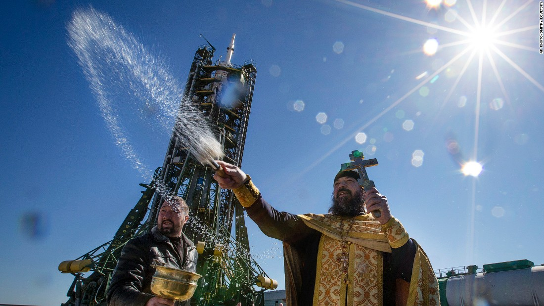 MARCH 26 - KAZAKHSTAN: An Orthodox priest conducts a blessing service in front of the Soyuz TMA-16M spacecraft at the Russian-leased Baikonur cosmodrome. The new Soyuz mission is scheduled for March 28.