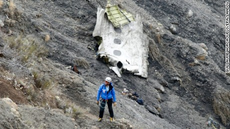A search and rescue worker at the crash site of the Germanwings Airbus A320 that crashed in the French Alps, above the town of Seyne-les-Alpes, southeastern France, 25 March 2015. Search crews resumed helicopter flights around dawn on 25 March to the remote mountainside where Germanwings Flight 4U 9525 from Barcelona to Duesseldorf crashed after a rapid descent, likely killing all 150 people aboard on 24 March.