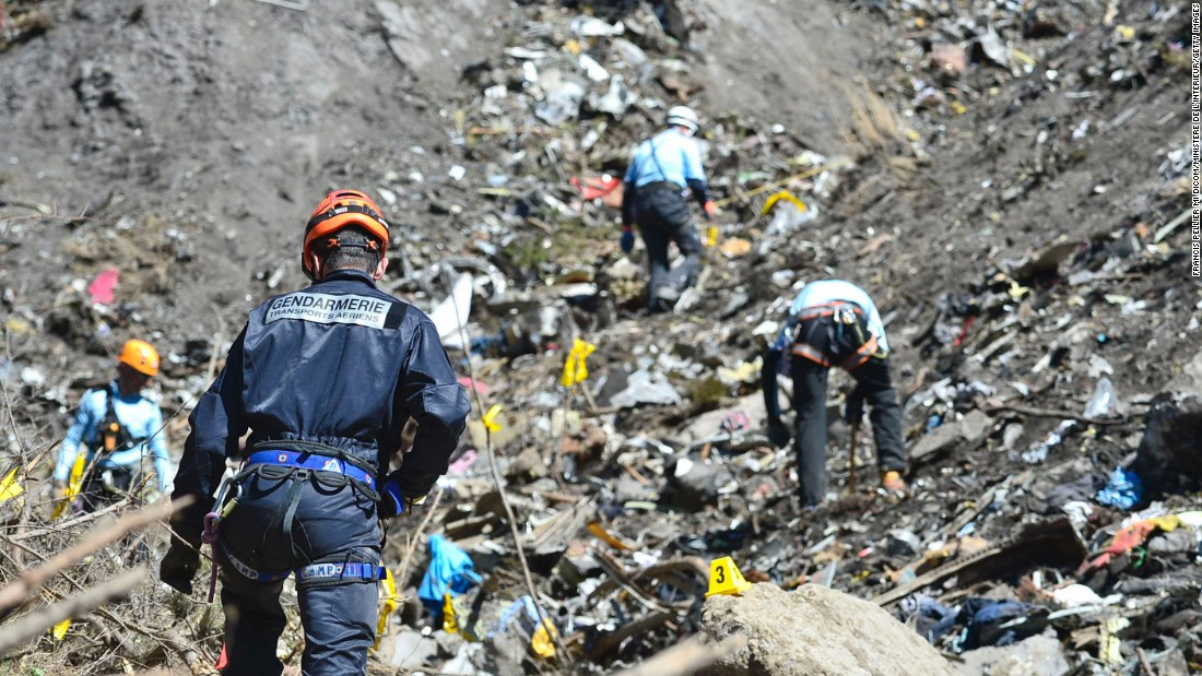Rescue workers continue to search the site of the crash on March 26.