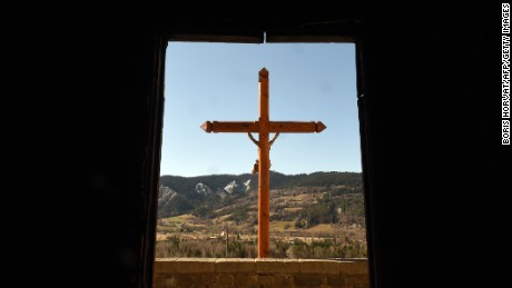 A Christian cross is pictured at Seyne-les-Alpes in the French Alps on Friday, March 27, a day after families of victims arrived on the site near the plane crash. Germanwings Flight 9525 was carrying at least 150 people when it crashed in the French Alps on Tuesday.