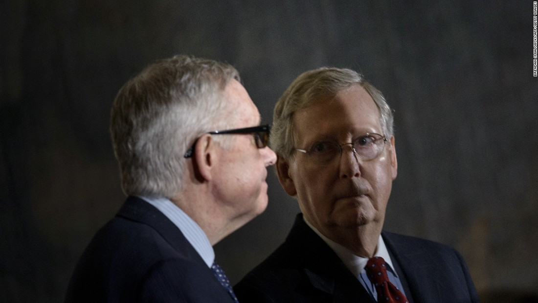 Reid and McConnell arrive for a Congressional Gold Medal ceremony.