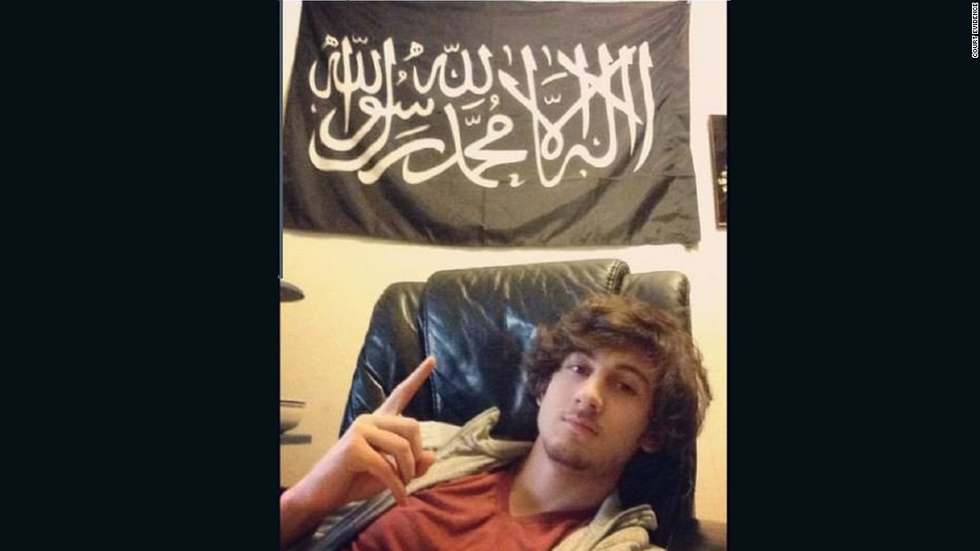 Tsarnaev poses in front of a black standard adopted by various militant Islamist groups in this Instagram photo that was entered as evidence.