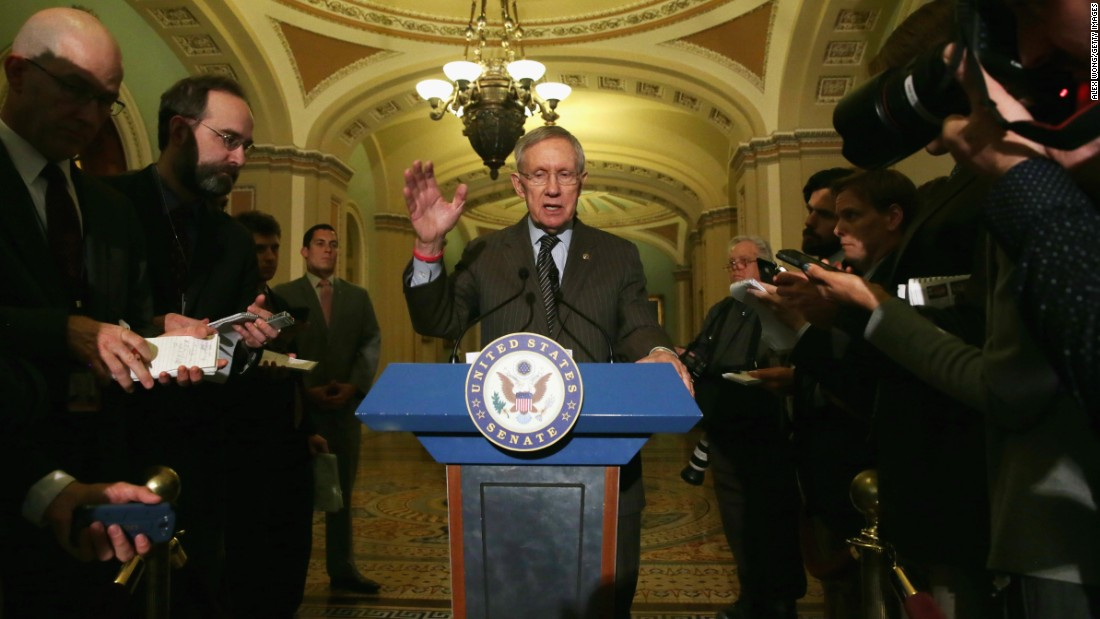 Reid speaks to members of the media after a policy luncheon May 6, 2014 on Capitol Hill.