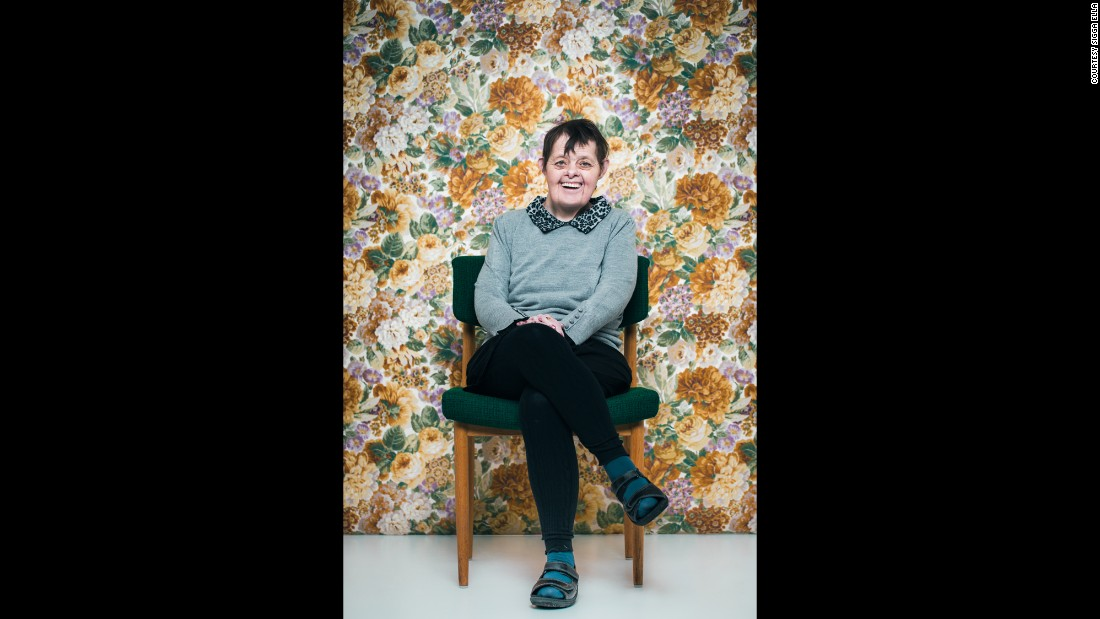 "Bjork, age 55. ""We don't often see older people with Down syndrome, and individuals with Down syndrome are often portrayed as being the same,"" photographer Sigga Ella said. ""My goal was to show diverse personalities in a broad age range, to show that although they share the syndrome, they are all unique."""