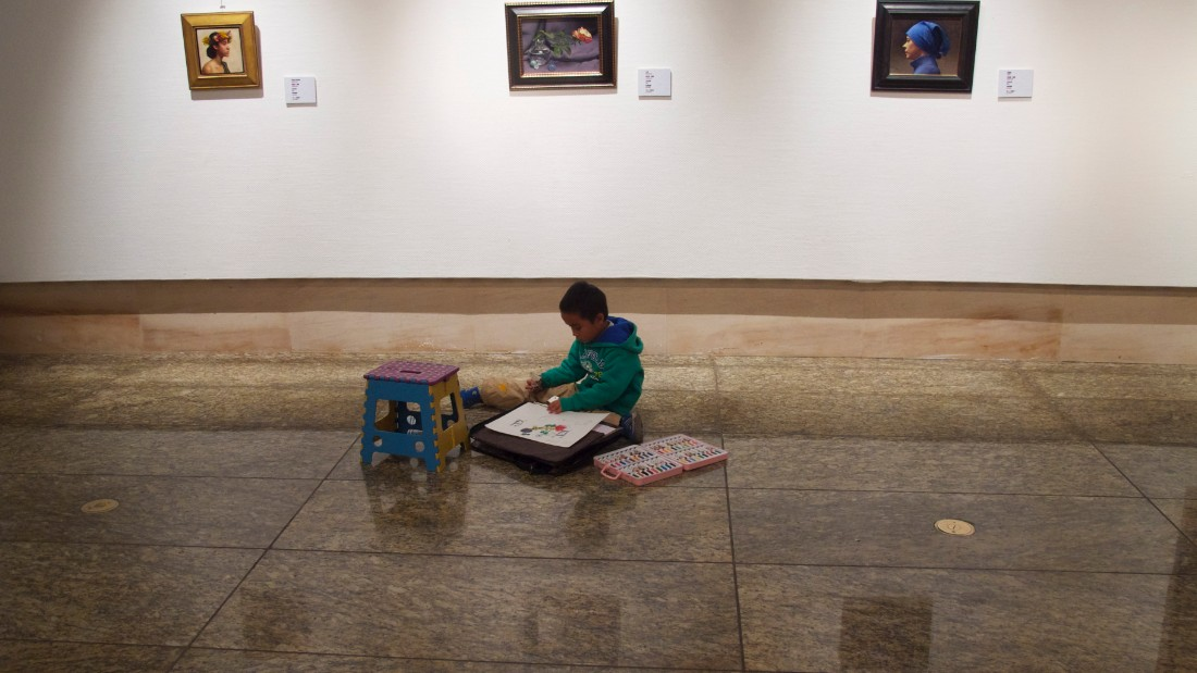 A boy draws in the National Art Museum of China, Beijing 2012.