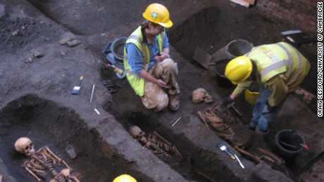 Researchers excavate the cemetery site during refurbishment of the Old Divinity School.