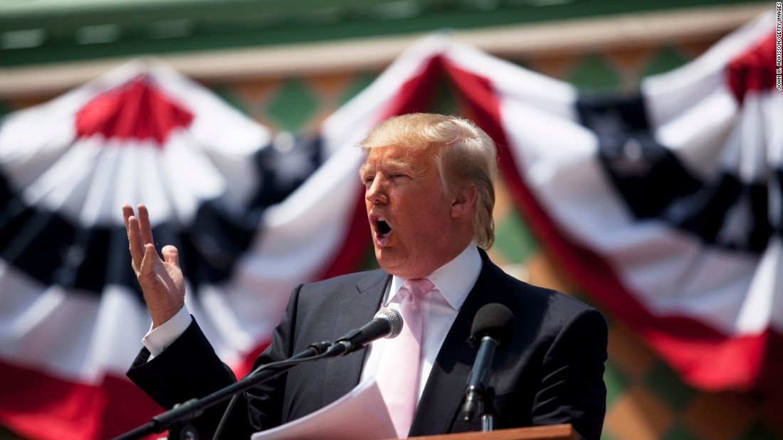 Trump speaks to a crowd at the Palm Beach County Tax Day Tea Party on April 16, 2011, at Sanborn Square in Boca Raton, Florida.