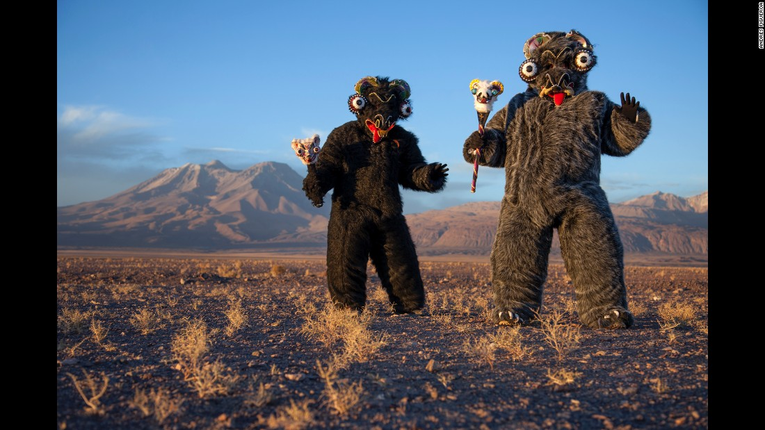 Jeannete Valenzuela and Katherine Gonzalez dress in costume for a religious festival in Ayquina, Chile, last July. Photographer Andres Figueroa spent time in the Atacama Desert chronicling festivals that attract thousands of people to otherwise quiet mining towns in Chile.