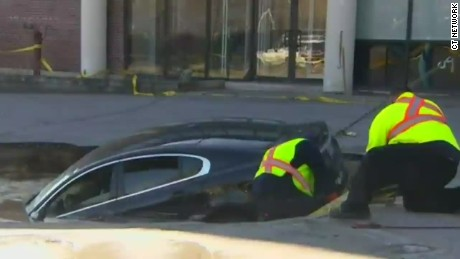 vo canada sinkhole swallows car_00000000