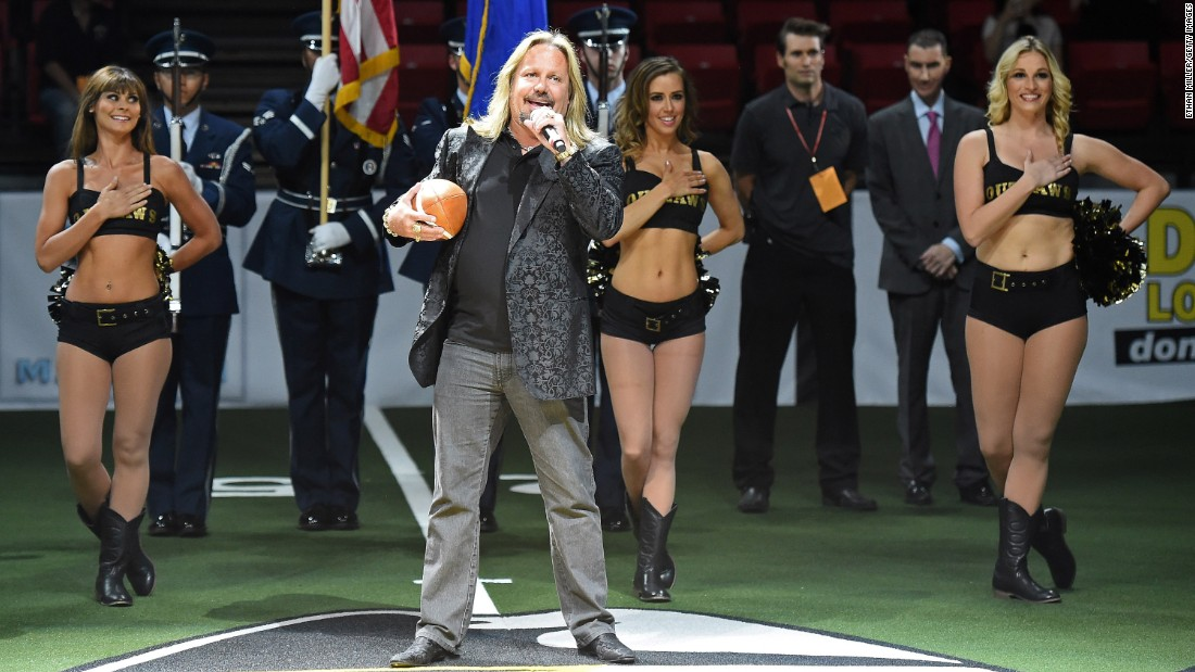 Motley Crue band member Vince Neil performs the national anthem before an arena football game between the Las Vegas Outlaws and the San Jose SaberCats on Monday, March 30, in Las Vegas.