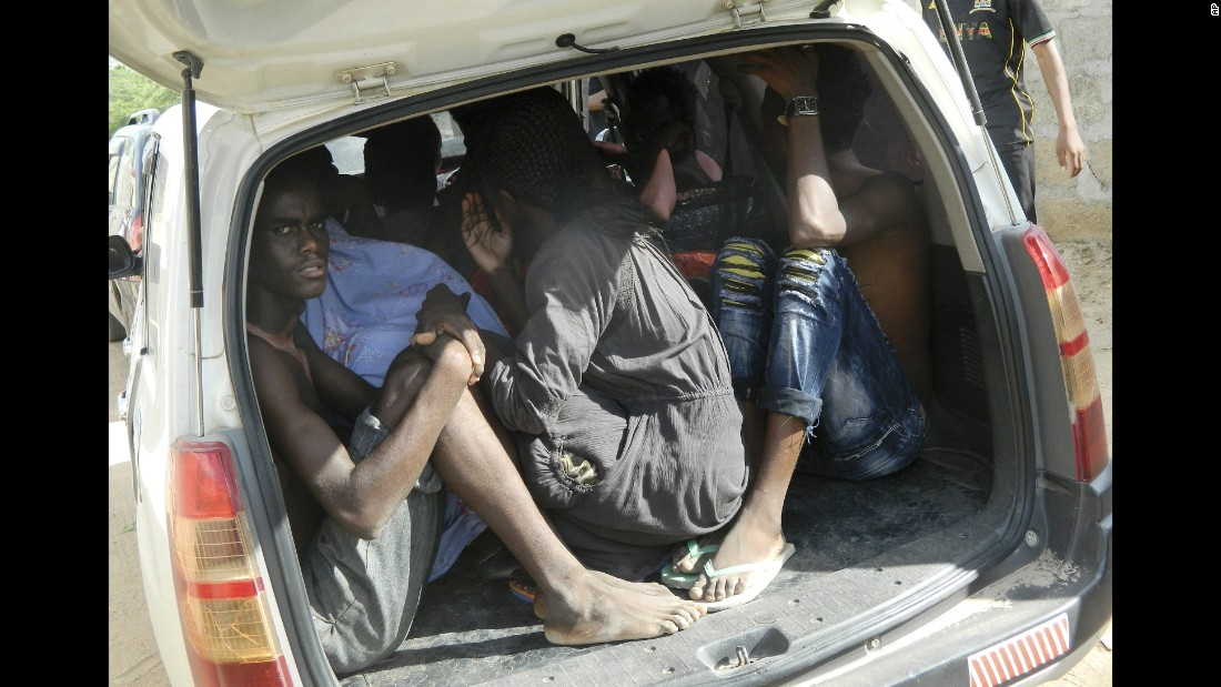 Students take shelter in a vehicle after fleeing the attack.