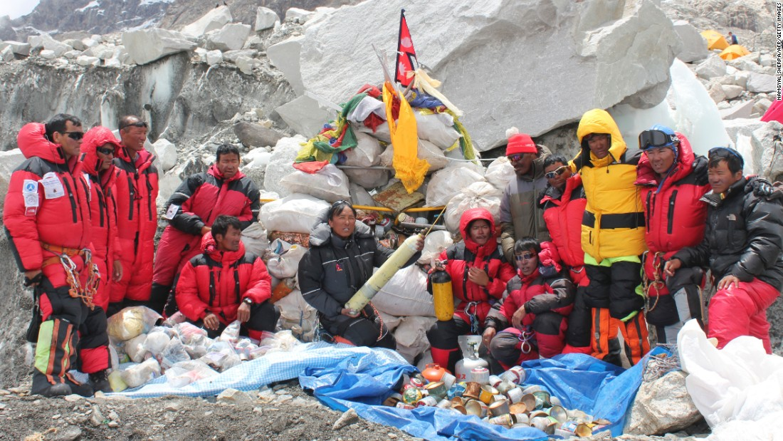 Sherpa climbers pose at Everest Base Camp after collecting garbage during the Everest cleanup expedition on May 28, 2010. A group of 20 Nepalese climbers collected nearly two tons of garbage in a high-risk expedition to clean up the world's highest peak.