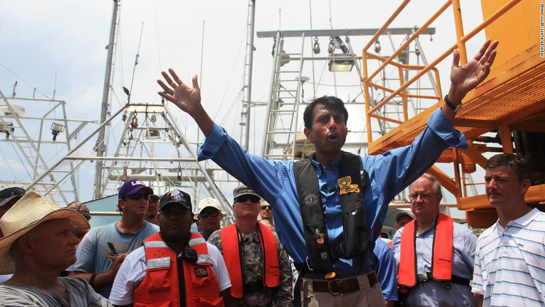 Jindal speaks with workers and fishermen involved in the cleanup effort of the BP oil spill on a command post boat in Barataria Bay on June 15, 2010, off Grand Isle, Louisiana.