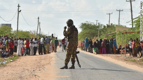 A Kenya Defence Forces soldier stands guard before they ended a siege by gunmen in the university campus of the northeastern town of Garissa on April 2, 2015. At least 70 students were massacred when Somalia's Shebab Islamist group attacked a Kenyan university today, the interior minister said, the deadliest attack in the country since US embassy bombings in 1998.  AFP PHOTO / CARL DE SOUZA        (Photo credit should read CARL DE SOUZA/AFP/Getty Images)