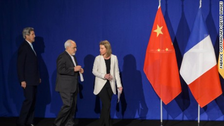 "(From L) US Secretary of State John Kerry (L to R) Iranian Foreign Minister Mohammad Javad Zarif and EU's foreign policy chief Federica Mogherini arrive to announce an agreement on Iran nuclear talks on April 2, 2015 at the The Swiss Federal Institutes of Technology (EPFL) in Lausanne. Iran and world powers said they had reached agreement on Thursday on ""key parameters"" of a potentially historic deal aimed at preventing Tehran from building the bomb."