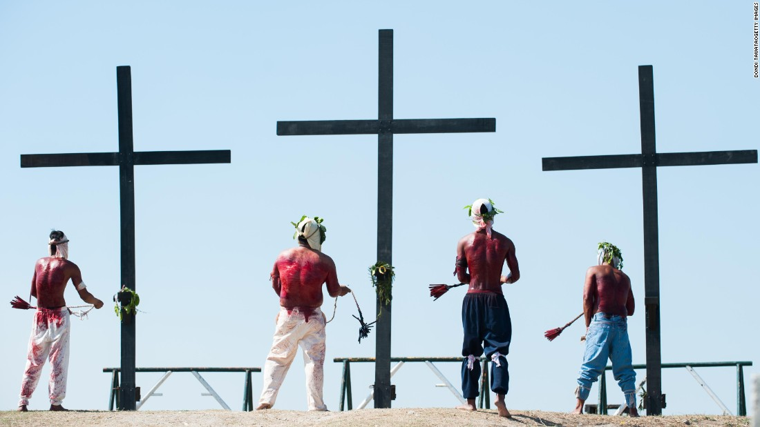 "Penitents in San Pedro Cutud, Philippines, kneel in front of crosses while whipping their backs in a <a href=""http://cnnphilippines.com/lifestyle/2015/04/03/Self-flagetllation-rituals-in-Santa-Lucia.html"" target=""_blank"">self-flagellation ritual</a> on April 3."