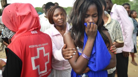 Students evacuated from Moi University during a terrorist seige react as they gather together in Garissa on April 3, 2015 before being transported to their home regions.