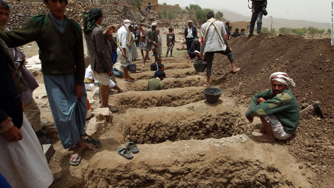 Yemenis dig graves on Saturday, April 4, to bury the victims of a reported airstrike by the Saudi-led coalition in the village of Bani Matar, Yemen.