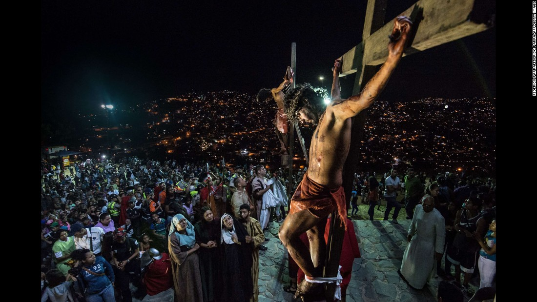 A Catholic devotee portrays Jesus Christ during a re-enactment of the crucifixion in the Petare shantytown in Caracas on Friday, April 3.