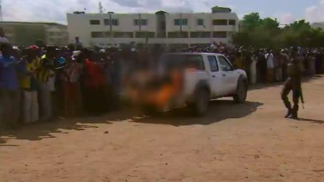 mckenzie pkg kenyan police parade bodies of alleged gunmen_00004527