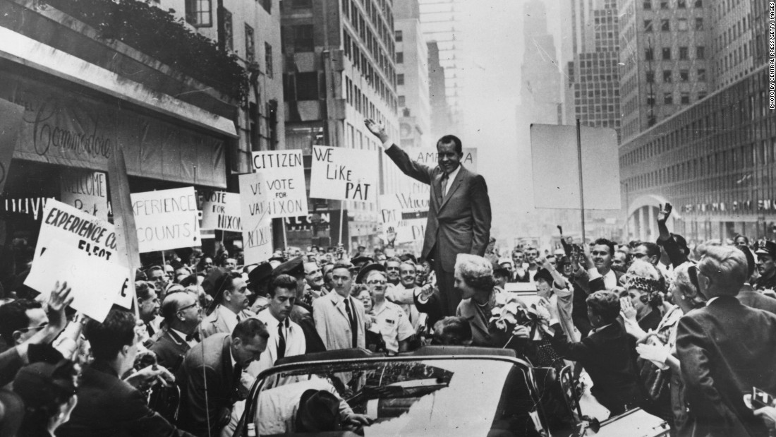 "Nixon's campaign slogan was ""For the Future."" He waves to the crowds with his wife, Pat, as he leaves the Hotel Commodore in New York on September 30, 1960."