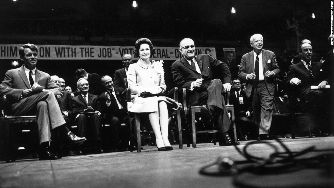 "Sen. Robert Kennedy, Lady Bird Johnson and President Lyndon Johnson attend an election rally on November 3, 1964, at Madison Square Garden in New York. Johnson's slogan was, ""The Stakes are Too High for You to Stay at Home."""