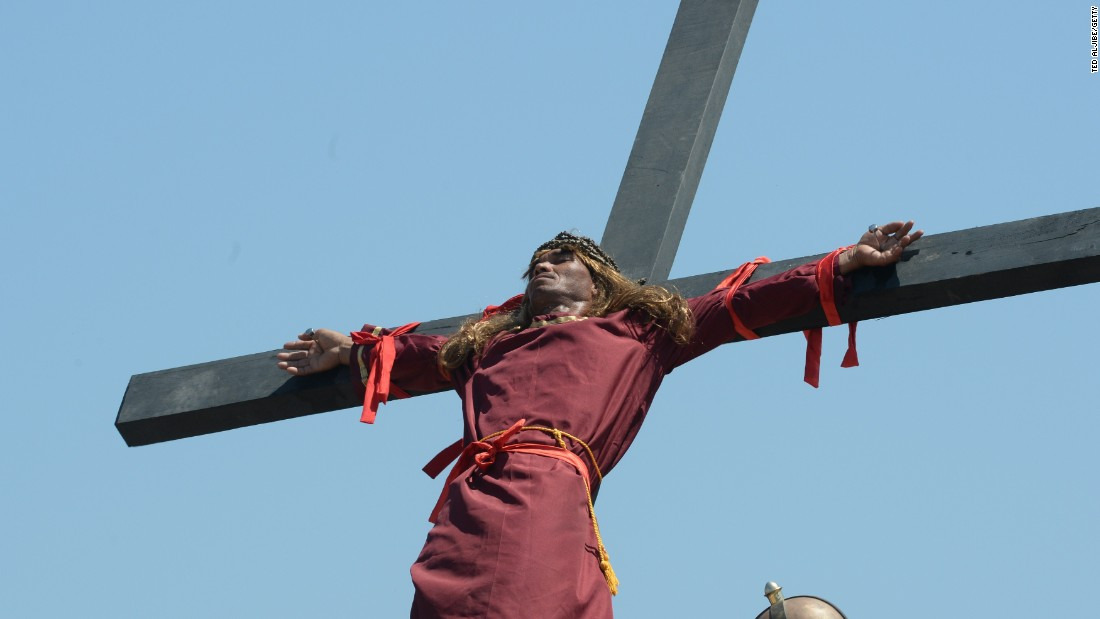 A penitent is nailed to a cross on April 3, 2015.