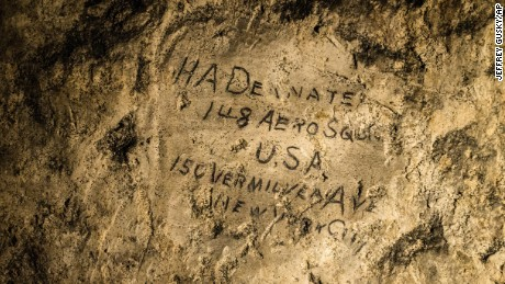 In this image made on Feb. 20, 2015 showing a name engraved on the walls of a former chalk quarry, at the Cite Souterraine, Underground City, in Naours, northern France by HA Deanate, 148th Aero Squadron, USA. 150 Vermilyea Ave, New York City, The names are just some of nearly 2,000 First World War inscriptions that have recently come to light here, a two-hour drive north of Paris, thanks to efforts by Jeffrey Gusky, the site's new owners and local archaeologist Gilles Prilaux.  (AP Photo/Jeffrey Gusky) Mandatory Credit