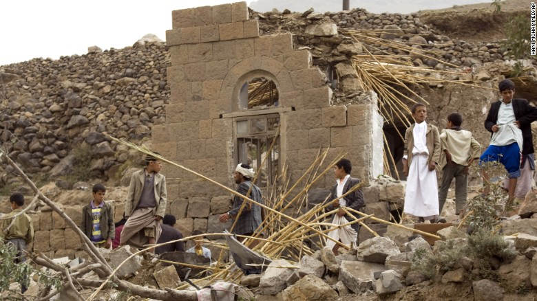 Yemenis gather as they search for survivors in the rubble of houses destroyed by Saudi-