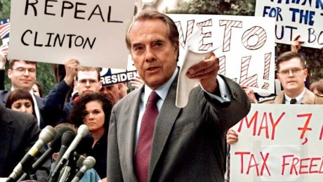 Republican presidential candidate U.S. Senator Bob Dole (center) pushes for a repeal of the 4.3 cent gas tax during a rally in front of the Internal Revenue Service.