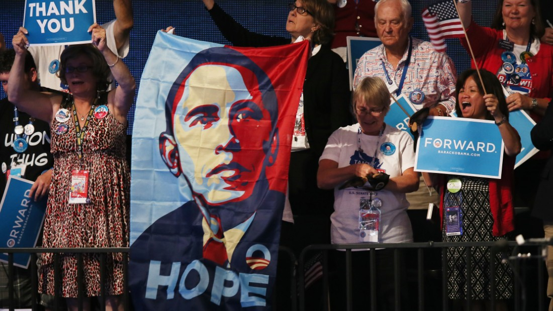 "People cheer as Obama speaks on stage as he accepts the nomination for president on September 6, 2012, in Charlotte, North Carolina. After his successful ""Hope and Change"" 2008 campaign, Obama ran for reelection on the slogan ""Forward."""