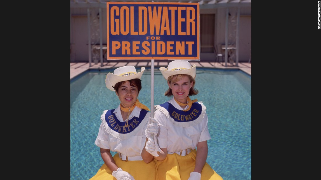 "Two ""Goldwater girls"" in July 1964 in Sherman Oaks, California, campaign for Barry Goldwater, the Republican candidate for president. Goldwater's campaign slogan was, ""In Your Heart You Know He's Right."""