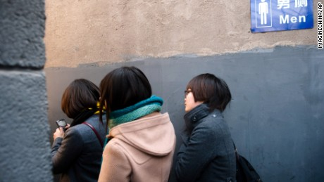 Chinese women line up at a mens toilet during the Occupying Toilets campaign in Beijing, China, 26 February 2012. Female students in Beijing on Sunday (26 February 2012) occupied cubicles in a mens toilet near Deshengmen. Their purpose was to make sure that women who were waiting outside could use the facilities first. Volunteers outside the toilet held banners demanding, More conveniences for women, more gender equality, and If you love her, do not let her wait in line. It is more difficult for women to answer the call of nature than for men as there are insufficient public womens toilets and the time women spend in the toilet is two or three times that of men, said organizer Li Tingting, 23, a university student from Beijing. Li staged the first occupation on February 19 at a public toilet in Guangzhou, and set off a fierce public debate. The urban management commission of Guangzhou responded last wee that since March, new and renovated womens toilet cubicles in Guangzhou have been required to cover an area at least 1.5 times that of a mens cubicle. Colleges and universities in Guangzhou have already enlarged womens cubicles. According to an online survey on Sina Weibo, a twitter-like microblogging service, about 84 percent of netizens, out of 2,824 who replied, were in favor of building more public toilets for women, while 9 percent were against it.