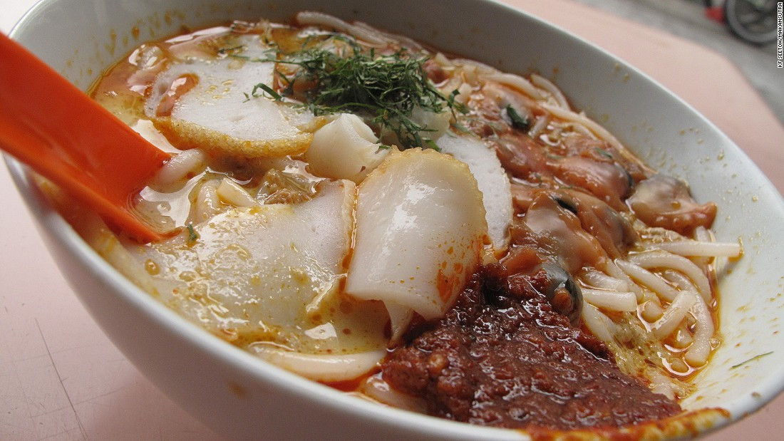 Sungei Road laksa is served simply, with a spoon to scoop all that goodness in one go.