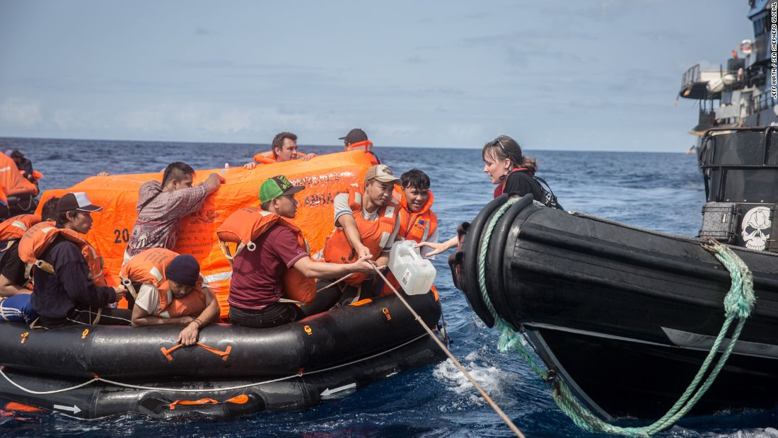 Sea Shepherd crew hand over water to the Thunder crew in life rafts.
